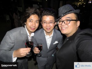 Artus and Kelvin Ong drinking wine with Brian Lee
